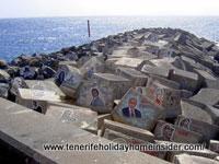 Celebrity images on breakwater stones of Tenerife concert hall Auditorio