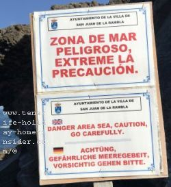 Danger notice board warns tourists and locals in three languages