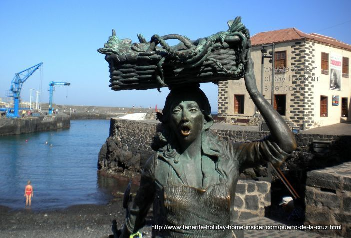 Fish seller sculpture fish wife at Puerto Cruz harbor