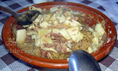 Popular Guachinche Gofio dish Escaldon of stewed meat and vegetables.