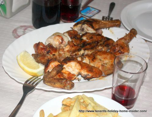 Guachinche chicken together with French fries and house wine all good and cheap