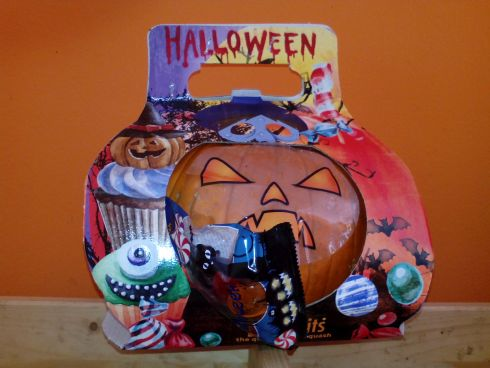 Halloween pumpkin with sweets on its back seen at the Longuera Market shop.