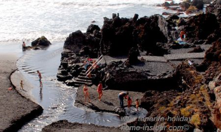 landscape design ideas with artificial beach river by a volcanic isle