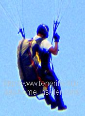 Paraglider pilot with seat, strings and backpack