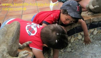Toddler fountain fun at Monasterio -Sam made a friend