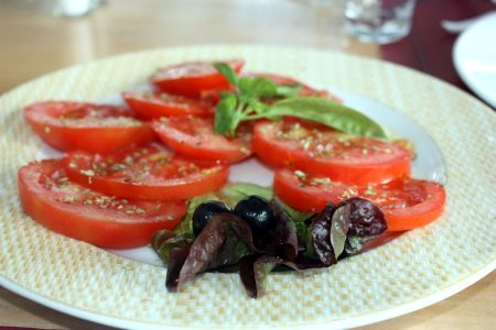 Tomato salad with perfect seasoning and oregano.