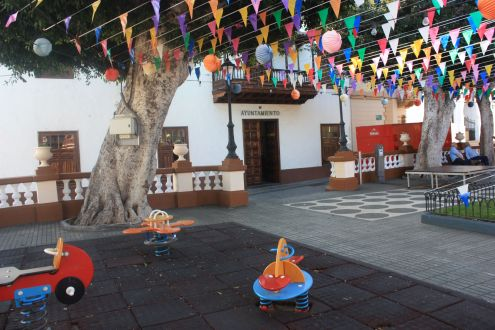 Town Hall Los Silos Tenerife with central town square and toddler play ground.
