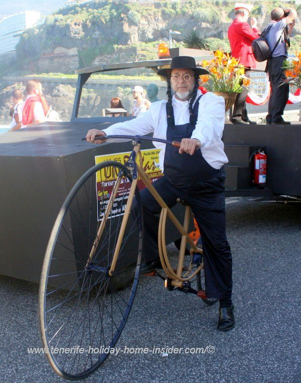 Vintage bicycle with cyclist dressed as a mormon.