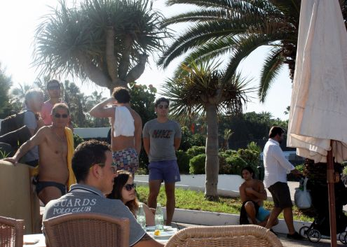 People waiting for a free table at the Terrace restaurant by beach Charcon of Playa Jardin beaches in January 2017.