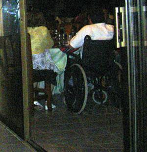 Man in wheelchair watching fireworks Los Realejos